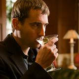 Man drinking martini.