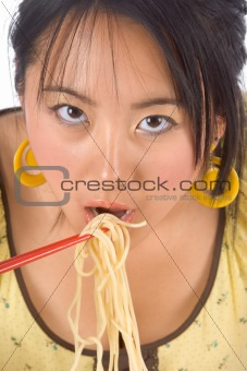 Eating noodles with chopsticks