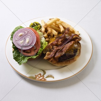 Bacon cheeseburger on plate.