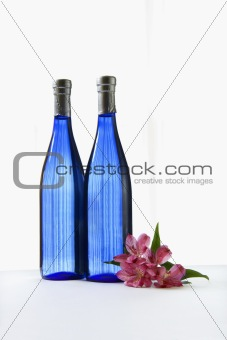 Blue bottles with flower.