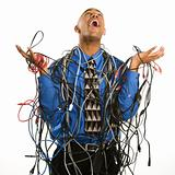 Man wrapped in cables.