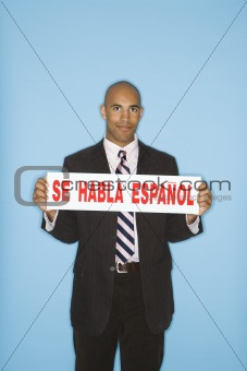 Businessman holding sign.