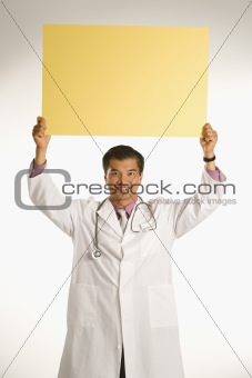 Doctor holding blank sign.