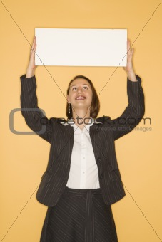 Businesswoman holding blank sign.