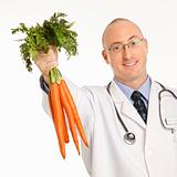 Doctor holding carrots.