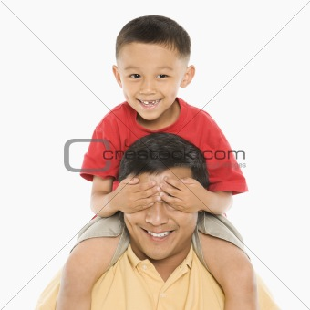 Boy on father's shoulders.