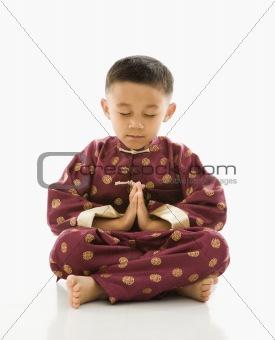 Asian boy in traditional attire.