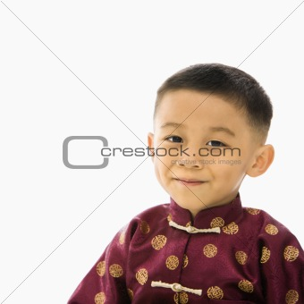 Boy in Asian costume.