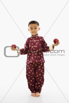 Boy holding apples.