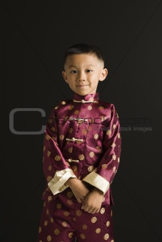 Asian boy in traditional attire.