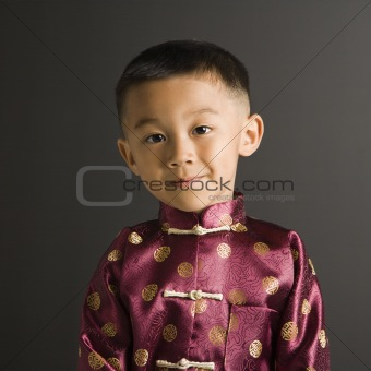 Asian boy in traditional costume.