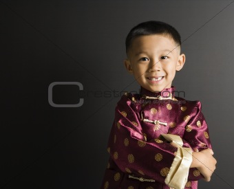 Smiling Asian boy.