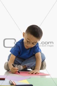 Boy coloring.