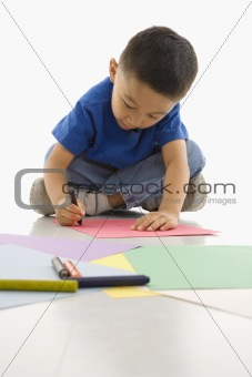 Boy drawing.