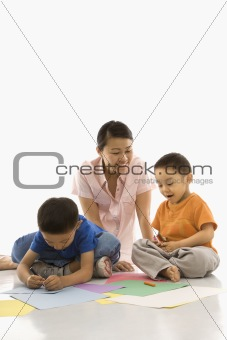 Boys coloring with mother.