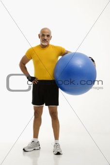 Man holding exercise ball.
