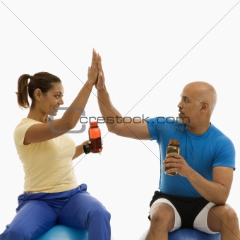 Two people high fiving.