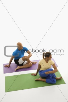 Man and woman stretching.