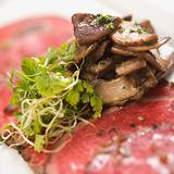 Beef carpaccio with mushrooms.
