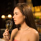 Woman drinking wine.