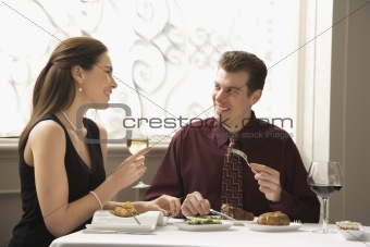 Couple dining at restaurant.