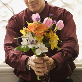 Man holding bouquet.
