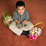 Boy with Easter baskets.