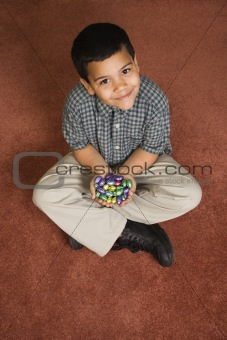 Boy holding Easter candy.
