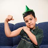 Boy flexing arm muscle.