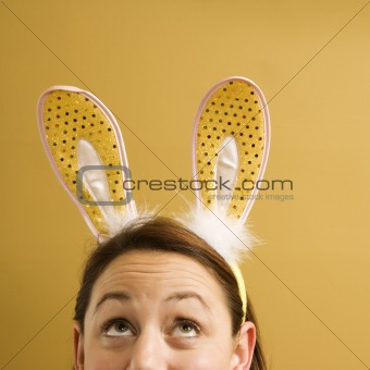 Woman wearing rabbit ears.