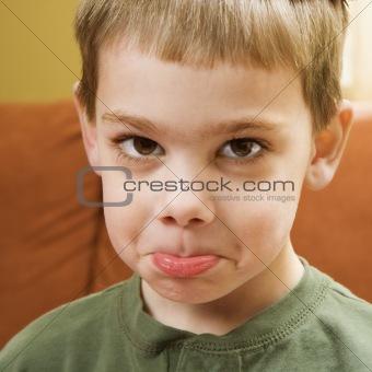 Boy pouting.
