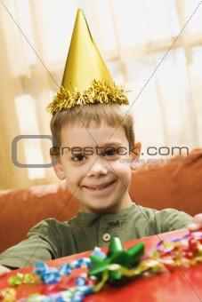 Boy holding birthday gift.