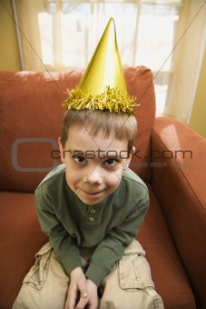 Boy in party hat.