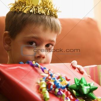 Boy holding gift.
