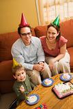 Family eating birthday cake.