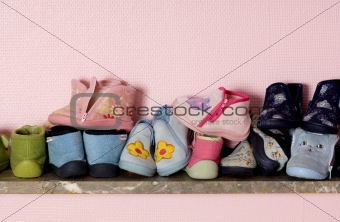 baby shoes on a shelves