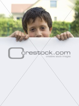 Boy keeps sheet of paper