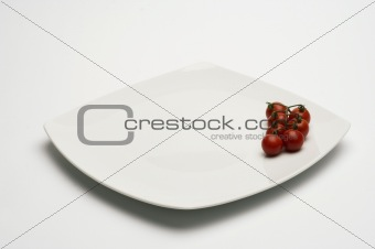 Tomatos in white plate