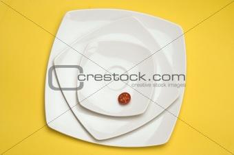 Tomato in white plate