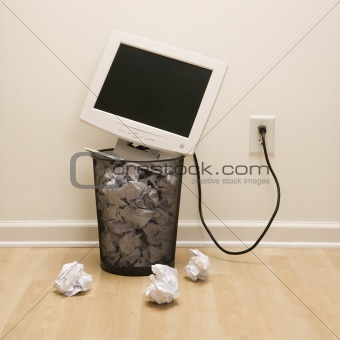 Computer in trash can.