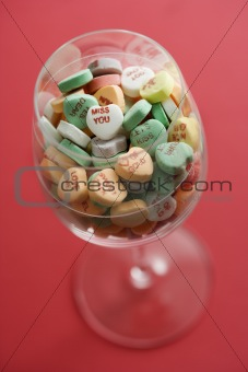 Candy hearts in glass.