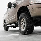 Four wheel drive truck with all terrain tires parked on desolate