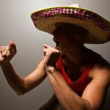 Dancing man wearing sombrero.