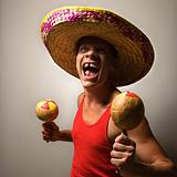 Man with sombrero and maracas.