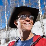 Man wearing cowboy hat.