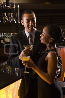 Couple at bar.