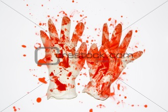 Blood covered rubber gloves.