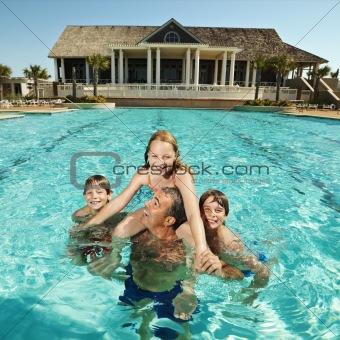 Family at pool.