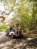 Family in golf cart.