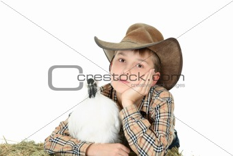 Country boy with farm animal with copyspace